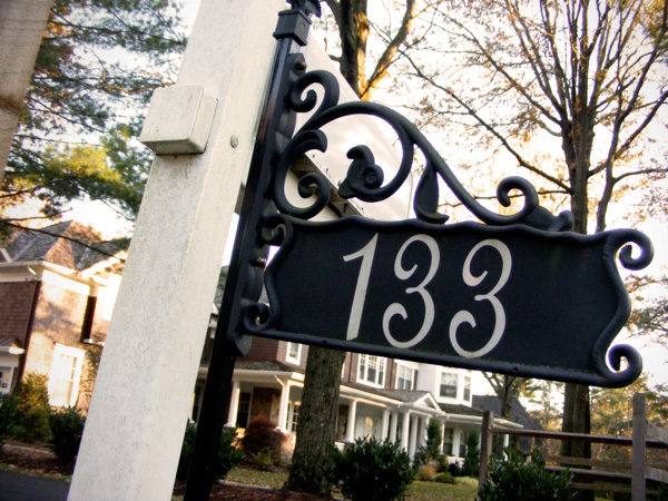 Frilly house sign