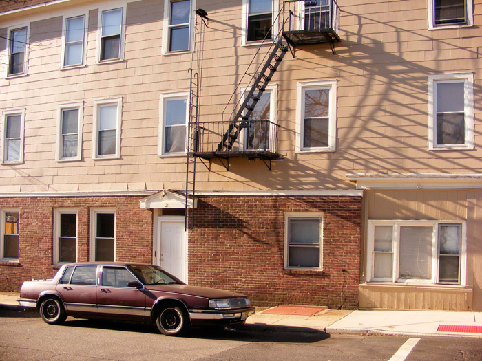 Just what it says, folks: a Buick and a fire escape.