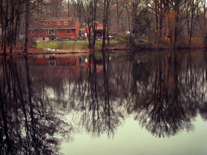 It is a red house on a lake. Come on, what do you want from me, a song and dance?
