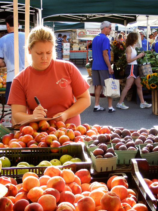 Makin' signs at the farmer's market