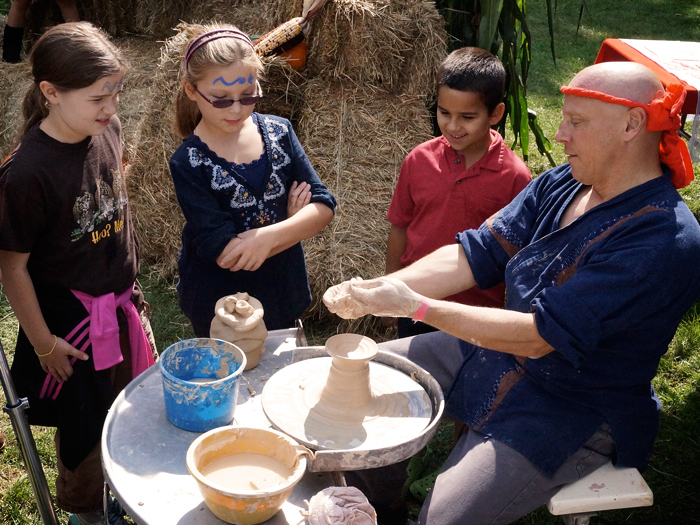Simon B. Keller, giving a brief pottery lesson at the Union County Harvest Festival