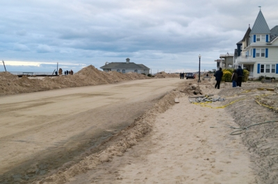 Ocean Avenue, a main scenic road connecting several of the central Jersey beaches, was covered with sand, which has been shoveled to the side.