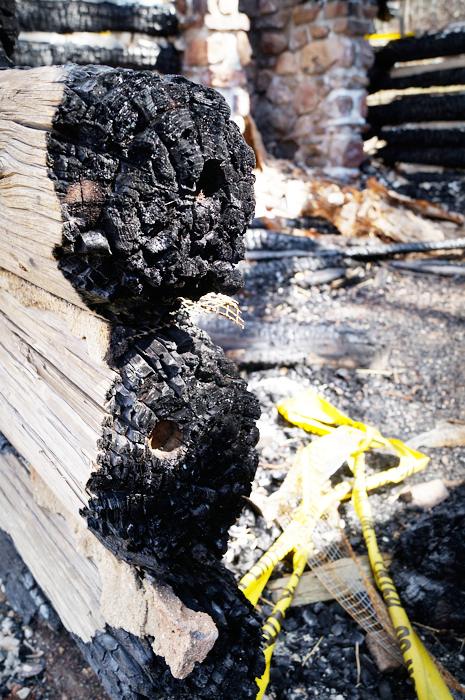 Charred ends of the cabin