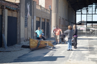 Playing in the trashed Asbury Park lifesaving boat.